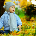 Baby at the park in autumn